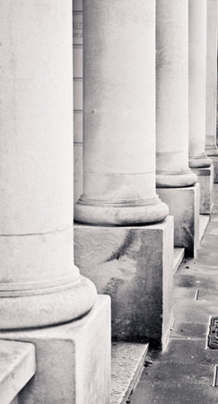 ouside: Row of stone pillars on the ouside of an urban building