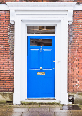 english house: A blue front door in an english house Stock Photo