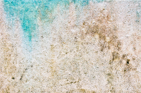 Colorful pattern in a stone surface caused by moisture and limescale