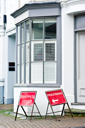 stating: Signs on a city pavement stating footpath is closed Stock Photo