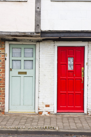 neighbouring: Neighbouring red and blue front doors Stock Photo