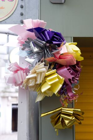 stall: Colorful ribbons hanging on a market stall