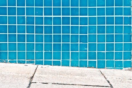 tiled wall: Sloping pavement in front of a blue tiled wall Stock Photo