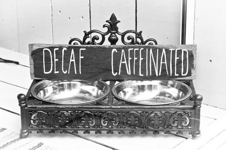 decaffeinated: Antique coffee bean holder Stock Photo