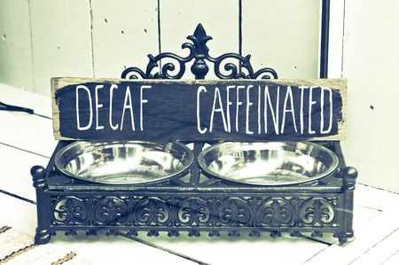 decaf: Antique coffee bean holder Stock Photo