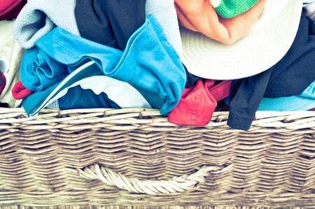 hamper: Childrens clothes in a wicker hamper