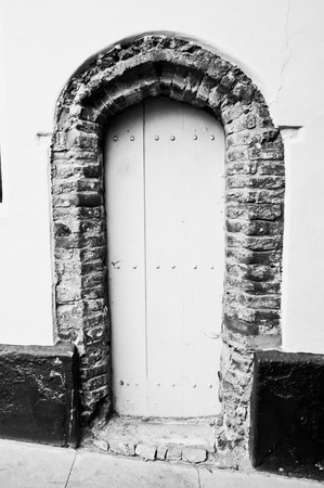 doorway: An old arch doorway in a wall Stock Photo