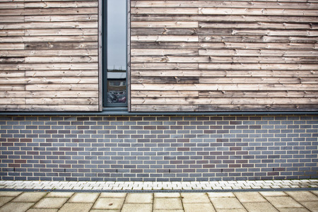 eco building: Brick and wooden wall on a modern eco building