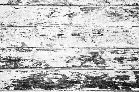 Old wooden panels with peeling paint as a background image