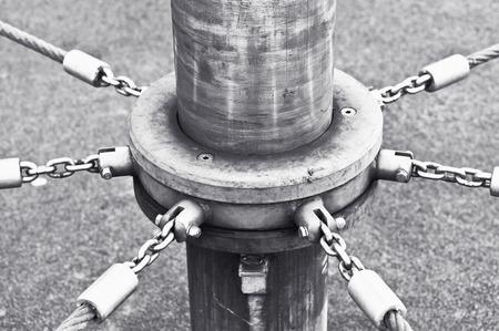 centred: Chains and rope attached to a pole on a playground climbing frame