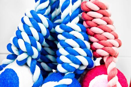 Red and blue rope toys close up as a background image