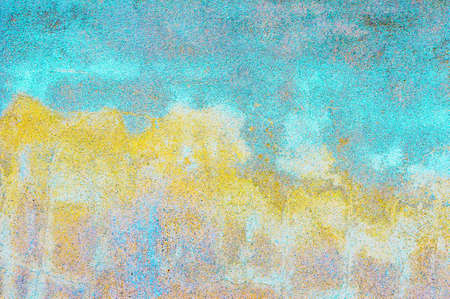 tints: A weathered stone wall with blue and yellow tints, as a background texture