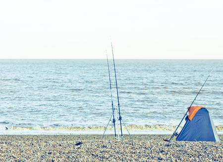 hobbyist: Fishing rods and a tent on a UK beach Stock Photo
