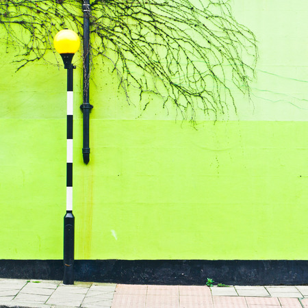 zebra: A light at a zebra crossing in front of a green wall in London, UK Stock Photo