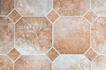 floor covering: Beige colored vinyl tiles on a kitchen floor Stock Photo