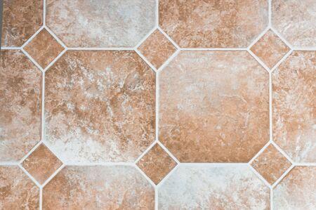 Beige colored vinyl tiles on a kitchen floor Stock Photo