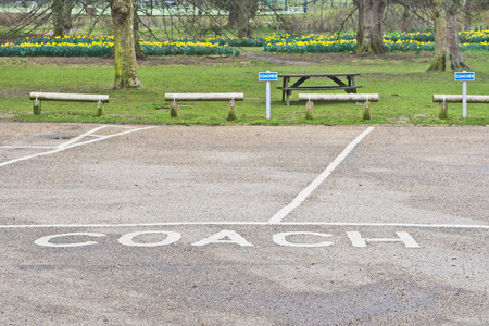 parking spaces: Parking spaces reserved for coaches in a park in the UK Stock Photo