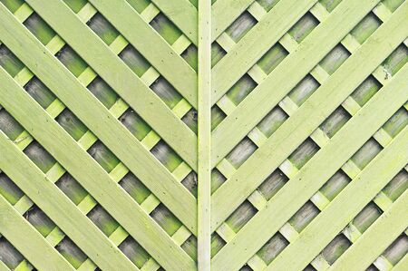 criss cross: Part of a garden fence with a criss cross pattern as a background image
