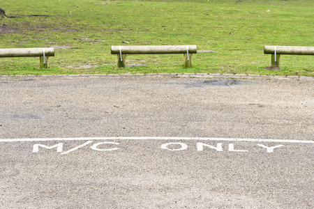 designated: Designated parking area for motorcycles in a public park in the UK