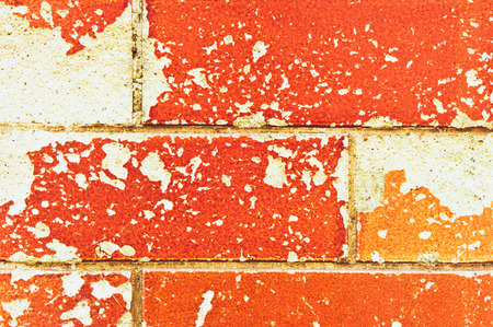 underlying: Glazed brown bricks damages exposing underlying stone Stock Photo