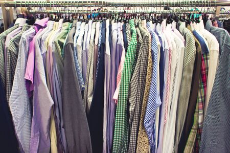 clothes rail: Selection of casual mens shirts on a clothing rack
