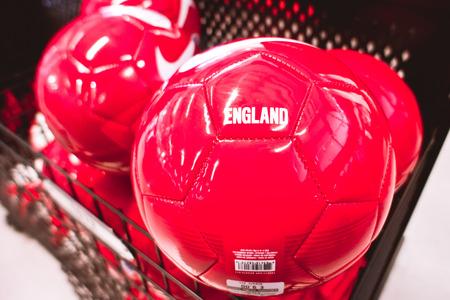 nike: BURNHAM, UK - APRIL 19 2015: Red Nike branded footballs for sale in a UK store.