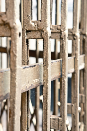 incarcerated: Metal bars in front of a shop Stock Photo
