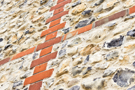 flint: Close up of part of a flint stone and brick wall on the exterior of an english building