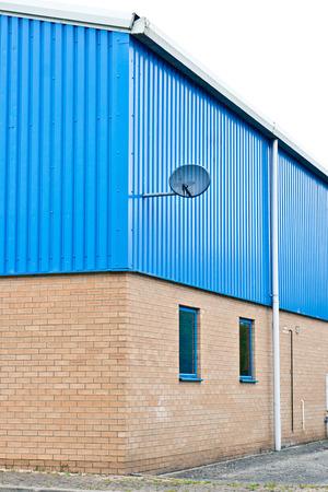 sattelite: Corner of a modern warehouse building in the UK Stock Photo