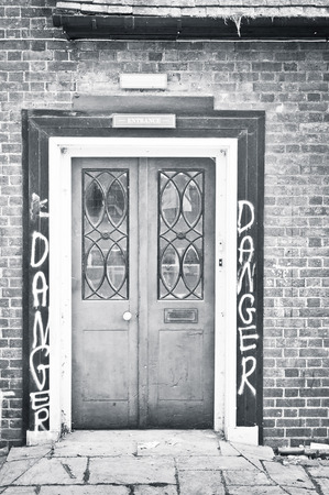 building feature: A door in a building with danger signs Stock Photo