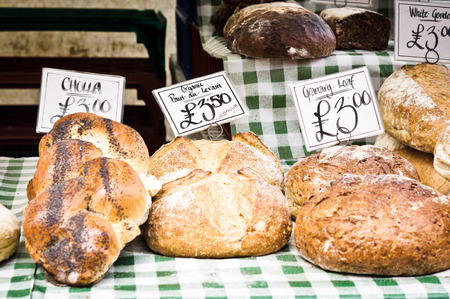 bakery shop: Loaves of fresh organic bread at a market in England