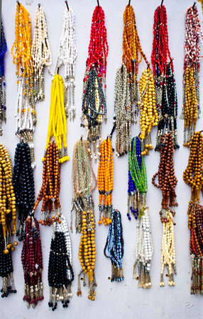 personal god: Selection of traditional prayer beads on display at a Turkish market