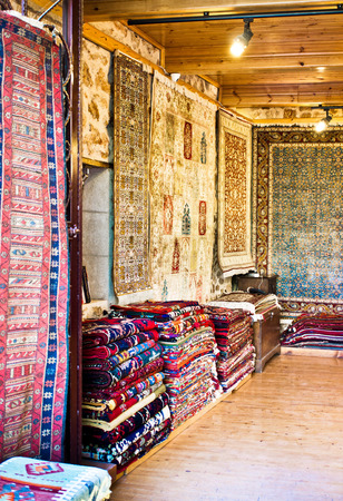 Inside of a store selling traditional rugs and carpets in Turkey Imagens