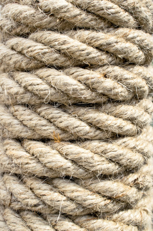 entwined: Close up of part of a rope wrapped around a post