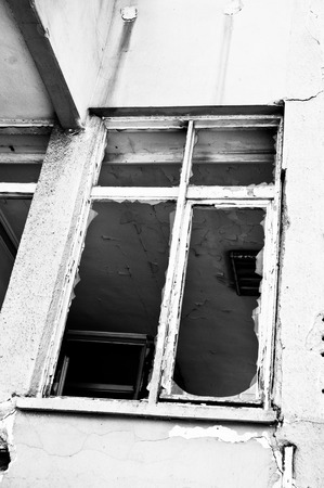 derelict: A broken window in a derelict building