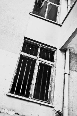 iron barred: A broken window in a derelict building