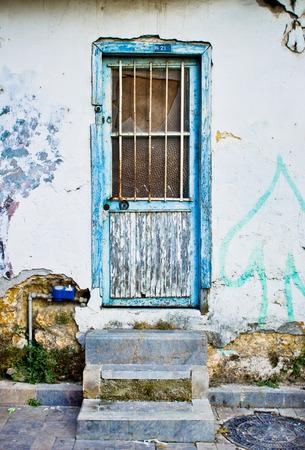derelict: A weathered wooden door in a derelict building Stock Photo