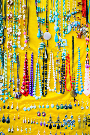ear rings: Souvenir jewellery on display at a turkish market Stock Photo