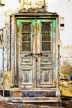 An old double door in a derelict building