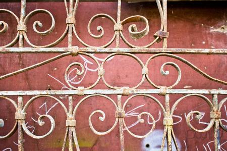 metal gate: Part of an old ornate metal gate