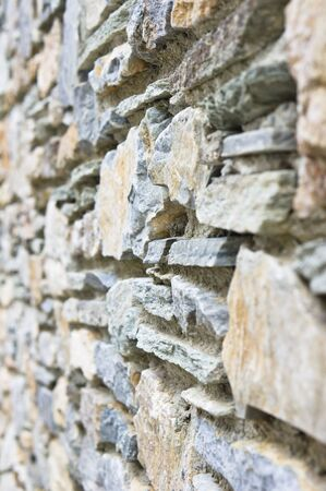 stonemason: Part of a stone wall with selective focus