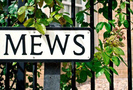 neighbourhood: Part of a street sign for a Mews neighbourhood, in the UK Stock Photo