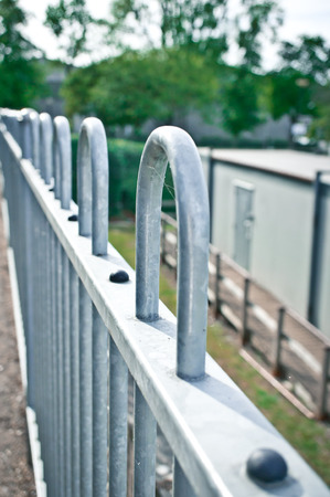 entrance gate: Part of a metal railing with selective focus Stock Photo