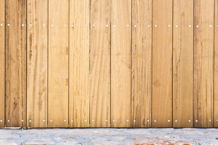 fence panel: Part of a new wooden fence on a stone surface Stock Photo