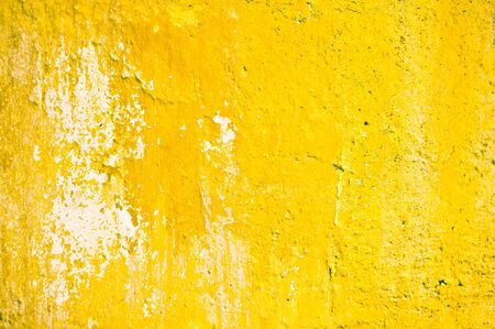 yellow stone: A yellow stone wall which is weathered Foto de archivo