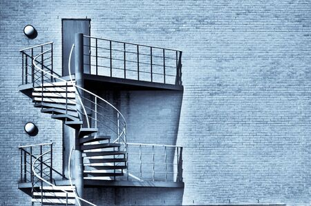 emergency stair: Spiral staircase on the outside of a modern building