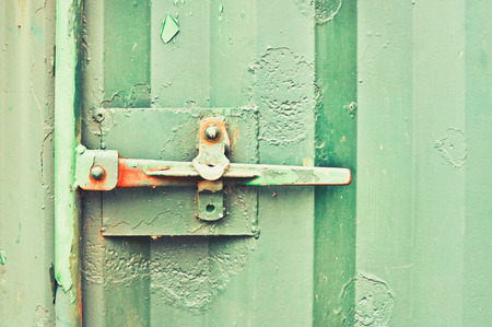 latch: A latch on a rusty metal container