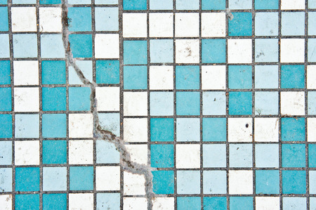 upkeep: Part of a tiled surface with a crack Stock Photo