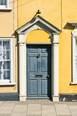 A Grey Front Door In A Yellow House Stock Photo Picture And Royalty
