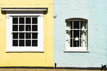 Neighboring yellow and blue painted town houses in the UK